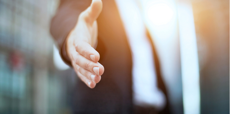 Businessperson holding out hand to shake